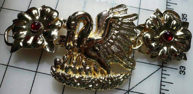 Pelican cloak clasp