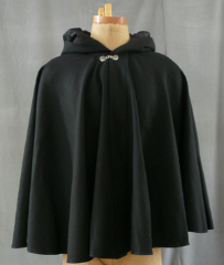 "Cloak:1720, Cloak Style:Full Circle Cloak, Cloak Color:Black, Fiber / Weave:Med Wt Washed Wool Twill, Cloak Clasp:Alpine Knot - Silvertone, Hood Lining:Black Embossed Poly Moleskin, Back Length:30"", Neck Length:20"", Seasons:Summer, Fall, Spring."