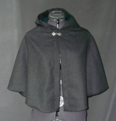 "Cloak:1745, Cloak Style:Half Circle Child's, Cloak Color:Dark Charcoal Grey, Fiber / Weave:Brushed Gabardine Wool Cash, Cloak Clasp:Fleur de Lis, Hood Lining:Dark Green Poly Moleskin, Back Length:21"", Neck Length:19.5"", Seasons:Spring, Fall, Winter."