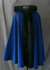 "Cloak:1748, Cloak Style:Full Circle Cloak, Cloak Color:Deep Medium Blue, Fiber / Weave:MicroGrid WindPro Fleece, Cloak Clasp:Medallion, Hood Lining:Self-lining, Back Length:35"", Neck Length:24"", Seasons:Winter, Fall, Spring."