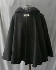 "Cloak:1761, Cloak Style:Full Circle Short Cloak, Cloak Color:Black, Fiber / Weave:Corded Wool - vert stripe, Cloak Clasp:Vale, Hood Lining:Dusty Dark Plum Cotton Velvet, Back Length:27.5"", Neck Length:23"", Seasons:Winter, Fall, Spring."