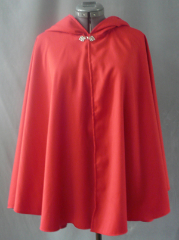 "Cloak:1820, Cloak Style:Full Circle Short Cloak, Cloak Color:Red, Fiber / Weave:rayon polyester, Cloak Clasp:Fleur de Lis, Hood Lining:Self-lining, Back Length:30"", Neck Length:21"", Seasons:Summer, Fall, Spring."