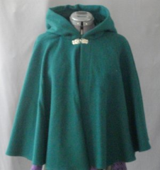 "Cloak:1823, Cloak Style:Full Circle Short Cloak, Cloak Color:Forest Green, Fiber / Weave:Washed Wool Flannel, Cloak Clasp:Florentine - Small, Hood Lining:green cotton velvet, Back Length:23.5"", Neck Length:21"", Seasons:Summer, Fall, Spring."
