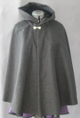 "Cloak:1824, Cloak Style:Shaped Shoulder-Short Cloak, Cloak Color:Dark Heathered Grey, Fiber / Weave:Merino Wool, Cloak Clasp:Dragon Knot, Hood Lining:Black Cotton Velvet, Back Length:27"", Neck Length:20"", Seasons:Winter, Fall, Spring."