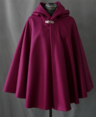 "Cloak:1831, Cloak Style:Full Circle Short Cloak, Cloak Color:Raspberry, Fiber / Weave:Wool Melton, Cloak Clasp:Florentine - Small, Hood Lining:Plum Moleskin, Back Length:28"", Neck Length:22"", Seasons:Winter, Fall, Spring."