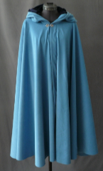 "Cloak:1838, Cloak Style:Full Circle Cloak, Cloak Color:Sky Blue, Fiber / Weave:Polyester Moleskin, Cloak Clasp:Fleur de Lis, Hood Lining:Navy Polyester Velour, Back Length:38"", Neck Length:23"", Seasons:Summer, Fall, Spring."