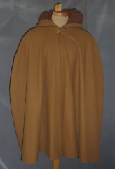 "Cloak:1913, Cloak Style:Shaped Shoulder, Cloak Color:Cinnamon Brown, Fiber / Weave:Wool Melton, Cloak Clasp:Double Spiral, Hood Lining:Self-lining, Back Length:35"", Neck Length:20"", Seasons:Winter, Fall, Spring."