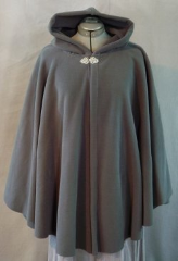Cloak:1924, Cloak Style:Cape / Ruana, Cloak Color:Dark Storm Grey, Fiber / Weave:WindPro Fleece, Cloak Clasp:Tree of Life, Hood Lining:Self-lining, Back Length:33&quot;, Neck Length:23&quot;, Seasons:Winter, Fall, Spring, Note:This storm grey ruana is great for stormy weather! <br>Made of a wind-resistant fleece with a water-resistant finish. <br>Finished with a pewter Tree of Life hook-and-eye clasp. <br>A cross between a cape and a cloak, a ruana is a great way <br>to keep warm while frequent, unhindered use of your arms <br>is needed. Ruanas make great driving cloaks!.