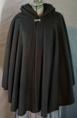 Cloak:1931, Cloak Style:Cape / Ruana, Cloak Color:Black, Fiber / Weave:WindPro Herringbone fleece, Cloak Clasp:Plain Rope<br>Hook & Eye, Hood Lining:Self-lining, Back Length:34&quot;, Neck Length:24&quot;, Seasons:Winter, Fall, Spring.
