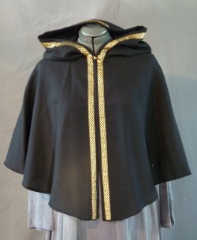 Cloak:1934, Cloak Style:Fuller Half circle with 4-Strand Celtic Gold Braid, Medium<br>on hood and edge, Cloak Color:Black, Fiber / Weave:Wool Crepe, Cloak Clasp:Double Spiral, Hood Lining:Unlined, Back Length:24&quot;, Neck Length:18&quot;, Seasons:Summer, Fall, Spring.