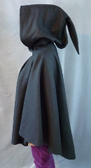 "Cloak:1945, Cloak Style:Cape / Ruana with pointed tail hood, Cloak Color:Black, Fiber / Weave:Heavy Wool Melton, Cloak Clasp:Medallion, Hood Lining:Unlined, Back Length:31"", Neck Length:23"", Seasons:Winter."