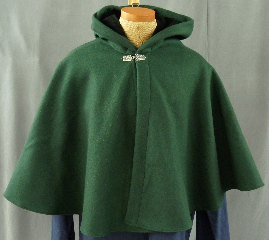 Cloak:1954, Cloak Style:Full Circle Short Cloak, Cloak Color:Forrest Green, Fiber / Weave:Heavy Wool Melton, Cloak Clasp:Florentine - Small, Hood Lining:Black Cotton Velveteen, Back Length:24&quot;, Neck Length:21.5&quot;, Seasons:Winter, Fall, Spring, Note:This short cloak is a full-circle made of a forest green <br>heavy wool melton and features a full-sized hood lined <br>with black cotton velveteen. <br>Finished with a small pewter Florentine hook-and-eye clasp..