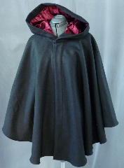 Cloak:1962, Cloak Style:Cape / Ruana, Cloak Color:Black, Fiber / Weave:Heavy Felted Wool Melton, Cloak Clasp:Florentine - Small, Hood Lining:Maroon Polyester longpile Velvet, Back Length:33&quot;, Neck Length:23.5&quot;, Seasons:Winter, Fall, Spring, Note:This ruana is made of a heavy black felted wool <br>melton. Full-sized hood features a lining of luxurious <br>long-pile polyester Maroon velvet. <br>Finished with a small pewter Florentine hook-and-eye clasp. <br>A cross between a cape and a cloak, a ruana is a great way <br>to keep warm while frequent, unhindered use of your arms <br>is needed. Ruanas make great driving cloaks!.