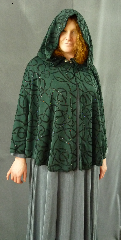 "Cloak:1981, Cloak Style:Fuller Half circle, Cloak Color:Hunter Green flocked with Black and Multi-color glitter, Fiber / Weave:Polyester / Nylon, Cloak Clasp:Fleur de Lis, Hood Lining:Unlined, Back Length:32"", Neck Length:19.5"", Seasons:Summer, Fall, Spring."