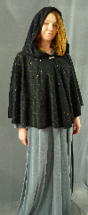Cloak:1982, Cloak Style:Short Full Circle, Cloak Color:Black flocked with Black and Multi-color glitter, Fiber / Weave:Polyester / Nylon, Cloak Clasp:Fleur de Lis, Hood Lining:Unlined, Back Length:27&quot;, Neck Length:25&quot;, Seasons:Summer, Note:This short full circle cloak is perfect <br>for adding just a touch of drama and elegance.<br>Made from a flocked polyester with an eyecatching<br> black and multi-coloured glitter overlapping swirl design.<br>Features an oversized hood, unlined.<br>Finished off with a cute Fleur de Lis hook-and-eye clasp.<br>Perfect for Summer, late Spring, early Fall evenings.