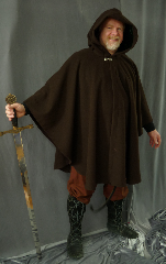 Cloak:1984, Cloak Style:Cape / Ruana, Cloak Color:Brown, Fiber / Weave:Wool / nylon, Cloak Clasp:Dragon Knot, Hood Lining:Rich Green Velvet, Back Length:39&quot;, Neck Length:23&quot;, Seasons:Southern Winter, Fall, Spring, Note:This cloak features a full-sized hood lined with a rich green velvet<br>and finished with a pewter dragon knot clasp.<br>Great for  mild Winter temperatures or Spring and Fall,<br>the smaller neck size makes it  a good fit for someone on the smaller side.<br>Now on sale!<br> A cross between a cape and a cloak, a ruana is a great way to keep warm<br>when  frequent, unhindered use of your arms is needed.<br>Ruanas make great driving cloaks!.
