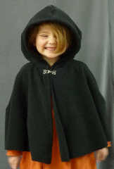 Cloak:1998, Cloak Style:Shaped Shoulder - Short (Youth), Cloak Color:Black, Fiber / Weave:WindPro Fleece, Cloak Clasp:Plain Rope<br>Hook & Eye, Hood Lining:Self-lining, Back Length:17&quot;, Neck Length:16&quot;, Seasons:Winter, Fall, Spring, Note:This is a short shaped shoulder cloak,<br>recommended for youngsters, about size 3T.<br>Features a small, unlined hood.<br>Made of WindPro Fleece, which is 60-70%<br> windproof and has a water-resistant finish.<br>Closes with a Plain Rope hook-and-eye clasp..