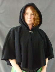 Cloak:1999, Cloak Style:Full Circle Short Cloak, Cloak Color:Black, Fiber / Weave:WindPro Fleece, Cloak Clasp:Plain Rope<br>Hook & Eye, Hood Lining:Self-lining, Back Length:25&quot;, Neck Length:20&quot;, Seasons:Winter, Fall, Spring, Note:WindPro Fleece short full circle cloak.<br>The fabric is 60-70% wind resistant and sheds water.<br>Features full size, unlined hood to fit an adult<br>or could be used for a child.<br>Closes with a Plain Rope hook-and-eye clasp..