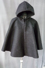 Cloak:2002, Cloak Style:Full Circle Short Cloak, Cloak Color:Black, Fiber / Weave:Heavy Wool Melton, Cloak Clasp:Plain Rope<br>Hook & Eye, Hood Lining:Unlined, Back Length:26&quot;, Neck Length:23&quot;, Seasons:Winter.