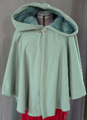 Cloak:2006, Cloak Style:Full Circle Short Cloak, Cloak Color:Seafoam Green, Fiber / Weave:WindPro Polar Fleece, Cloak Clasp:Medallion, Hood Lining:Self-lining, Back Length:26&quot;, Neck Length:21&quot;, Seasons:Winter, Fall, Spring, Note:The extravagant look and comfort of a full cloak lining<br> without the worry of uneven stretching,<br> plus extraordinary wind resistance!<br> This gorgeous seafoam green short cloak appears<br> to be fully lined with seafoam green fur, <br>but actually it is just one fabric!<br> In fact, it&#039;s WindPro Polar Fleece, which is 60-70% wind resistant! <br>This cloak features a full hood and closes with<br> a Medallion hook-and-eye clasp..