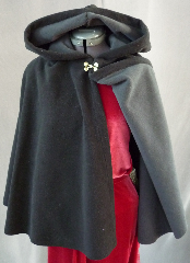 "Cloak:2009, Cloak Style:Full Circle Short Cloak, Cloak Color:Black outside Grey inside, Fiber / Weave:Windblock Polar Fleece, Cloak Clasp:Double Spiral, Hood Lining:Self-lining (Grey), Back Length:23.5"", Neck Length:19"", Seasons:Winter, Fall, Spring."