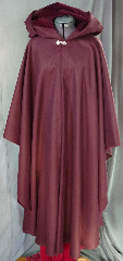 "Cloak:2014, Cloak Style:Cape / Ruana, Cloak Color:Burgundy, Fiber / Weave:100% camel hair, Cloak Clasp:Fleur de Lis, Hood Lining:Dark Burgundy Cotton Velveteen, Back Length:47"", Neck Length:21.5"", Seasons:Winter, Fall, Spring."