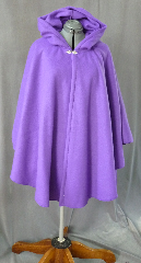 Cloak:2022, Cloak Style:Ruana, Cloak Color:Vibrant Grape Purple, Fiber / Weave:Polyester Fleece, Cloak Clasp:Fleur de Lis, Hood Lining:Unlined, Back Length:37&quot;, Neck Length:23&quot;, Seasons:Spring, Fall, Note:A great way to keep warm in the spring and autumn months,<br> this polyester fleece ruana is a striking vibrant<br> grape purple. Features a full hood and closes with a<br> Fleur de Lis hook-and-eye clasp..