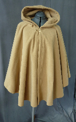 Cloak:2025, Cloak Style:Full Circle Short Cloak, Cloak Color:Camel, Fiber / Weave:Windblock Polar Fleece, Cloak Clasp:Double Spiral, Hood Lining:Self-lining, Back Length:35&quot;, Neck Length:24&quot;, Seasons:Winter, Fall, Spring, Note:This short golden tan ruana / poncho style cloak is made of  WindBloc Polar fleece, which is 100% wind resistant,<br> and has a water-repelling outer finish! It&#039;s perfect<br>for New England winters and cold, rainy, windy climates.<br>The inside of the fabric wicks up moisture keeping you dry and warm. <br>Machine washable cold gentle, tumble dry low ONCE<br>with the inside out, allow to air-dry the rest of the way..