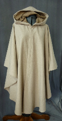 Cloak:2028, Cloak Style:Cape / Ruana, Cloak Color:Natural, Fiber / Weave:Wool, Cloak Clasp:Bavarian - Bronzetone, Hood Lining:Tan moleskin, Back Length:46&quot;, Neck Length:22.5&quot;, Seasons:Spring, Fall, Winter, Note:A simple, natural colored wool with a complimenting tan moleskin lined full hood. Finished with a bronze-tone Bavarian hook-and-eye clasp. <br>A cross between a cape and a cloak, a ruana is a great way <br>to keep warm while frequent, unhindered use of your arms <br>is needed. Ruanas make great driving cloaks!.