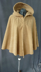 Cloak:2029, Cloak Style:Full Circle Short Cloak, Cloak Color:Golden Tan, Fiber / Weave:Windblock Polar Fleece, Cloak Clasp:Vale - Goldtone, Hood Lining:Self-lining, Back Length:29&quot;, Neck Length:22.5&quot;, Seasons:Winter, Fall, Spring, Note:This short golden tan full circle cloak is made of  WindBloc Polar fleece, which is 100% wind resistant,<br> and has a water-repelling outer finish! It&#039;s perfect<br>for New England winters and cold, rainy, windy climates.<br>The inside of the fabric absorbs moisture making it great for outdoor exercise. <br>Machine washable cold gentle, tumble dry low ONCE<br>with the inside out, allow to air-dry the rest of the way..