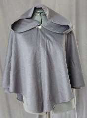 Cloak:2072, Cloak Style:Full Circle Short Cloak, Cloak Color:Grey, Fiber / Weave:50% Cashmere, 50% Wool, Cloak Clasp:Alpine Knot, Hood Lining:Unlined, Back Length:27&quot;, Neck Length:21.5&quot;, Seasons:Fall, Spring, Winter, Note:This short full circle cloak is perfect <br>for adding just a touch of drama and elegance.<br>Made from a dove grey 50% cashmere, 50% wool blend this lightweight cloak is cuddly soft.<br>Features an oversized hood, unlined.<br>Finished off with a silver-tone alpine style hook-and-eye clasp..