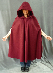 Cloak:2090, Cloak Style:Shaped Shoulder Cloak with arm slits, Cloak Color:Maroon/Burgundy/Cranberry, Fiber / Weave:Heavyweight 100% Wool Melton, Cloak Clasp:Vale, Hood Lining:Burgundy Cotton Velveteen, Back Length:39&quot;, Neck Length:23&quot;, Seasons:Winter, Fall, Spring, Note:If you need warmth with mobility, this cloak is for you.<br>Made from a heavy wool melton in cranberry red,<br>it has shaped shoulder and arm slits.<br>The hood is lined in a burgundy velveteen<br>and the cloak is finished with a pewter Vale clasp..