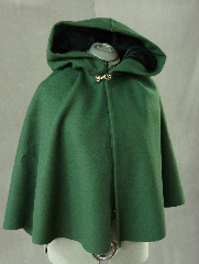 Cloak:2092, Cloak Style:Fuller Half Circle Short, Cloak Color:Forest Green, Fiber / Weave:100% Wool Melton, Cloak Clasp:Plain Rope<br>Hook & Eye, Hood Lining:Black Cotton Velvet, Back Length:26&quot;, Neck Length:17&quot;, Seasons:Winter, Fall, Spring, Note:This short cloak is a fuller half circle.<br>The smaller neck makes this a good choice for a child or small person.<br>It is made from a deep green wool melton<br> finished with a silvertone Plain Rope hook and eye clasp.<br>The hood, lined with black cotton velvet, adds a dash of elegance..