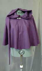 Cloak:2121, Cloak Style:Full Circle Short Cloak with Liripipe, Cloak Color:Imperial Purple, Fiber / Weave:Midweight wool twill, Cloak Clasp:Fleur de Lis, Hood Lining:Unlined, Back Length:23&quot;, Neck Length:21.5&quot;, Seasons:Fall, Spring, Note:This short full circle cloak is perfect<br>for adding just a touch of drama and elegance.<br>Made from a plum purple wool twill,<br>this midweight cloak is soft.<br>Features an oversized liripipe hood, unlined.<br>Finished off with a pewter fleur de lis hook-and-eye clasp.<br>Dry Clean..