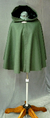Cloak:2123, Cloak Style:Full Circle Short Cloak, Cloak Color:Green, Fiber / Weave:Wool Melton, Cloak Clasp:Bavarian - Silvertone, Hood Lining:Green Rayon Acetate Velvet, Back Length:29&quot;, Neck Length:20&quot;, Seasons:Winter, Fall, Spring, Note:This short cloak is a full  circle.<br>The smaller neck makes this a good choice for a child or small person.<br>It is made from a deep green wool melton<br>finished with a silvertone Bavarian style hook and eye clasp.<br>The hood, lined with dark green velvet, adds a dash of elegance.<br>Dry Clean..