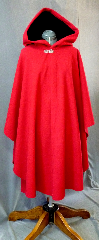 Cloak:2130, Cloak Style:Cape / Ruana, Cloak Color:Red, Fiber / Weave:Wool Melton, Cloak Clasp:Tree of Life, Hood Lining:Black Cotton Velveteen, Back Length:45&quot;, Neck Length:22&quot;, Seasons:Winter, Fall, Spring, Note:This crimson red cape is as plush and warm as it looks!<br>The black silk velvet in the full size hood lends drama and elegance.<br> It is closed by a pewter Tree of Life clasp.<br>A cross between a cape and a cloak, a ruana is a great way <br>to keep warm while frequent, unhindered use of your arms <br>is needed. Ruanas make great driving cloaks!.