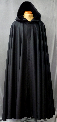 "Cloak:2157, Cloak Style:Full Circle Cloak, Cloak Color:Midnight Black, Fiber / Weave:Dense Black Wool Melton with brush finish, Cloak Clasp:Triple Medallion, Hood Lining:Black Cotton Velveteen, Back Length:58"", Neck Length:25"", Seasons:Winter, Fall, Spring."