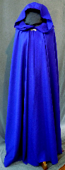 Cloak:2164, Cloak Style:Fuller Half circle, Cloak Color:Cobalt Blue, Fiber / Weave:Wool Gabardine, Cloak Clasp:Alpine Knot - Silvertone, Hood Lining:Unlined, Back Length:57&quot;, Neck Length:20&quot;, Seasons:Spring, Fall, Summer, Note:This beautiful royal blue cloak<br>is a great balance of luxury and value!<br>The actual cloak is darker than the picture.<br>The cloak is made of 100% wool gabardine<br>and features a dramatic full-sized hood<br>lined in a stunning blue crushed velvet, for even more elegance.<br>Finished with a lovely silver tone alpine style hook-and-eye clasp..