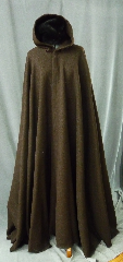 Cloak:2181, Cloak Style:Full Circle Cloak, Cloak Color:Brown, Fiber / Weave:100% Wool, Cloak Clasp:Triple Medallion, Hood Lining:Unlined, Back Length:55&quot;, Neck Length:23&quot;, Seasons:Winter, Fall, Spring, Note:This dark brown cloak is made of 100% wool basket weave fabric woven from chunky yarns.<br>  The brown is slightly heathered with gray. The generous full hood<br> is unlined, making it great for early period re-enactment..