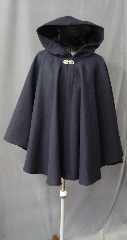 "Cloak:2206, Cloak Style:Cape / Ruana, Cloak Color:Dark Navy Blue, Fiber / Weave:80% Wool/ 20% Nylon Wide Herringbone tone on tone pattern, Cloak Clasp:Nordic Hearts - Silvertone, Hood Lining:Unlined, Back Length:30"", Neck Length:23"", Seasons:Winter, Fall, Spring, Note:Soft brushed Interior."