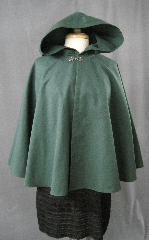 "Cloak:2338, Cloak Style:Full Circle Short Cloak, Cloak Color:Forest Green, Fiber / Weave:Cotton Twill, Cloak Clasp:Antiquity, Hood Lining:Unlined, Back Length:28"", Neck Length:19.5"", Seasons:Spring, Fall."