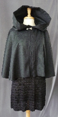 "Cloak:2359, Cloak Style:Full Circle Short Cloak, Cloak Color:Dark Charcoal Grey Heather, Fiber / Weave:Wool, Cloak Clasp:Gothic Round, Hood Lining:Unlined, Back Length:23"", Neck Length:25"", Seasons:Fall, Spring."