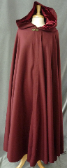 Cloak:2360, Cloak Style:Full Circle Cloak, Cloak Color:Cranberry Red, Fiber / Weave:Wool Gabardine, Cloak Clasp:Bavarian - Bronzetone, Hood Lining:Deep Red Rayon Acetate Velvet, Back Length:57&quot;, Neck Length:22&quot;, Seasons:Fall, Spring, Note:This beautiful &nbsp;cloak &nbsp;is a great balance of luxury and value!<br>The cloak is made of 100% wool gabardine and <br>features a dramatic full-sized hood is lined in a stunning<br>maroon washed velvet, for even more elegance.<br>Finished with a lovely bronze tone bavarian style hook-and-eye clasp.<br>Dry Clean only..