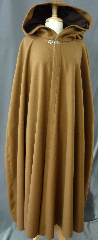 Cloak:2361, Cloak Style:Shaped Shoulder, Cloak Color:Cafe au Lait Brown, Fiber / Weave:100% wool melton, felted and brushed, Cloak Clasp:Vale - Goldtone, Hood Lining:Dark Brown Cotton Velveteen, Back Length:53&quot;, Neck Length:25&quot;, Seasons:Winter, Fall, Spring, Note:Made in a very neutral light golden brown,<br>this shaped shoulder cloak is made from a felted wool<br>thick enough to have some wind and water resistance.<br>Seams can be opened to create arm slits.<br>Sturdy and durable, this cloak will stand up to winter weather.<br>Dry Clean only..