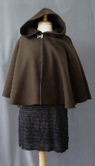 Cloak:2371, Cloak Style:Full Circle Short Cloak, Cloak Color:Brown, Fiber / Weave:100% Wool, Cloak Clasp:Double Spiral, Hood Lining:Unlined, Back Length:23&quot;, Neck Length:19&quot;, Seasons:Winter, Fall, Spring, Note:This dark brown cloak is made of 100% wool<br>basket weave fabric woven from chunky yarns.<br>The brown is slightly heathered with gray. The generous full hood<br>is unlined, making it great for early period re-enactment.<br>The smaller neck makes this a good choice for a<br>small child or petite person. Dry Clean..