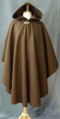Cloak:2395, Cloak Style:Cape / Ruana, Cloak Color:Brown, Fiber / Weave:100% wool melton, felted medium weight, Cloak Clasp:Vale, Hood Lining:Unlined, Back Length:44&quot;, Neck Length:21&quot;, Seasons:Southern Winter, Fall, Spring, Note:This medium brown, cape ruana is made from a felted<br>wool thick enough to have some &nbsp;wind and water resistance.<br>Sturdy and durable, this cloak will stand up to mild winter<br>weather. &nbsp;Dry Clean only..