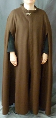Cloak:2399, Cloak Style:Shaped Shoulder Cloak with arm slits and collar, Cloak Color:Brown, Fiber / Weave:100% wool melton, felted medium weight, Cloak Clasp:Vale - Goldtone, Hood Lining:N/A, Back Length:55&quot;, Neck Length:24.5&quot;, Seasons:Southern Winter, Fall, Spring, Note:This medium brown, shaped shoulder cloak is made from a<br>felted wool thick enough to have some<br>wind and water resistance. &nbsp;With a<br>small band collar and front arm openings,<br>the cloak has a more formal air.<br>Sturdy and durable, this cloak will stand up to<br>mild winter &nbsp;weather. &nbsp;Dry Clean only..