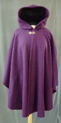Cloak:2402, Cloak Style:Cape / Ruana, Cloak Color:Rich Plum Purple, Fiber / Weave:Pill resistant mid weight fleece, Cloak Clasp:Vale - Goldtone, Hood Lining:Self-lining, Back Length:33.5&quot;, Neck Length:23.5&quot;, Seasons:Fall, Spring, Southern Winter, Note:A cross between a cape and a cloak,<br>a ruana is a great way to keep warm when<br>frequent, unhindered use of your arms is needed.<br>Midweight washable fleece provides a lightweight warmth.<br>&nbsp; Suitable for &nbsp;late spring, &nbsp;early fall or cool summer evenings.<br>You can even wrap up in it to watch TV,<br>safe from the savage winter drafts!.
