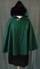 Cloak:2403, Cloak Style:Full Circle Short Cloak, Cloak Color:Green, Fiber / Weave:Fleece, Cloak Clasp:Fleur de Lis, Hood Lining:Self-lining, Back Length:27&quot;, Neck Length:23&quot;, Seasons:Fall, Spring, Note:This dark green cloak goes back to the basics.<br>It&#039;s a full circle cloak, made from a very soft,<br>light weight polyester fleece.<br>Finished with a simple pewter Plain Rope<br>style hook and eye clasp, it provides<br>a warmth with very little weight.<br>Suitable for indoor wear,&nbsp;late spring, &nbsp;early fall,<br>or cool summer evenings..