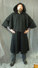 Cloak:2414, Cloak Style:Inverness Coat Cloak<br>with 22&quot; full circle mantle<br>and arm openings, Cloak Color:Black, Fiber / Weave:Wool Boucle Cape, Lambswool Cashmere, Cloak Clasp:Black snaps, Hood Lining:Unlined, Back Length:48&quot;, 22.5&quot; Mantle, Neck Length:22.5&quot;, Seasons:Winter, Fall, Spring, Note:This Coachman / Highwayman / Statesman<br>cloak features arm openings at the shoulder<br>and pockets on the sides.<br>The mantle is made of a soft<br>Wool Boucle over a lambswool cashmere..